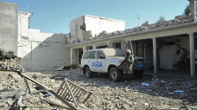 An Afghanistan National Civil Order Police (ANCOP) officer guards a building used by the UNHCR in Kandahar on Monday.