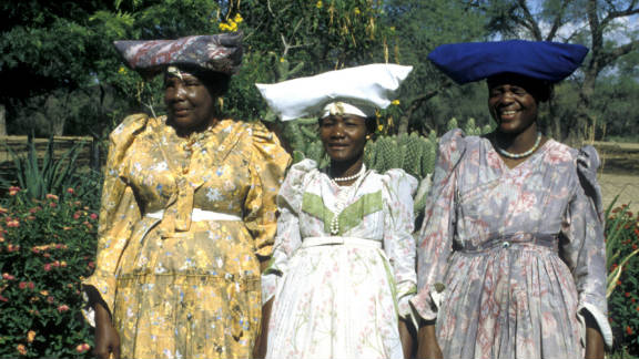 The long Victorian-period dresses are worn with numerous petticoats to add fullness to their skirts.