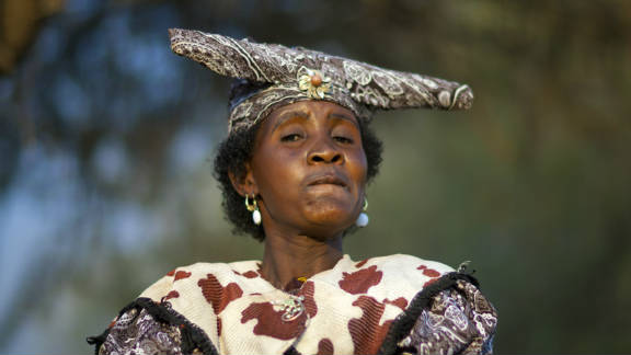 It is traditional that matching fabrics are used for the hat and dress.