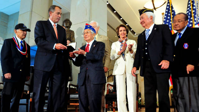 Speaker of the House John Boehner, left, hands the Congressional Gold Medal to a Japanese-American veteran on Wednesday.