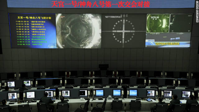 Scientists monitor the docking at the Jiuquan Satellite Launch Centre in the northwestern province of Gansu on November 3.