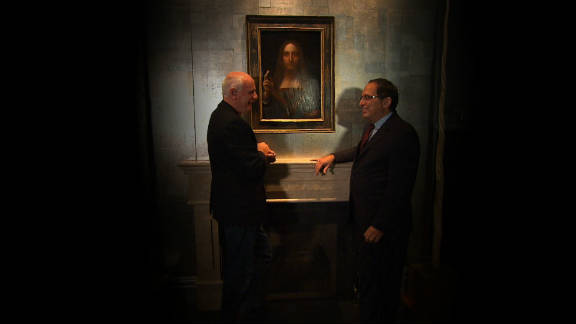 """CNN presenter Nick Glass with Robert Simon, the scholar and dealer who was asked to study the painting in 2005 and eventually discovered its true identity, in front of """"Salvator Mundi."""""""