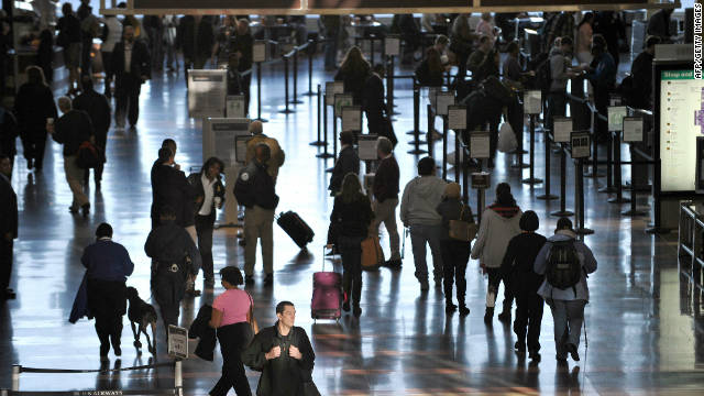 Travelers walk through Reagan National Airport in Washington ahead of Thanksgiving Day last year.