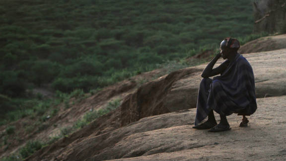 At dawn, one of the Kara village elders sits on his stool overlooking the Omo River Valley, a remote part of Ethiopia.