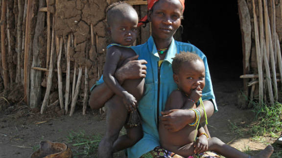 "Uri Betu is a foster mother for two mingi children: Tariqua, left, and Waiso, right. She says she tries not to think about the slow change to combat mingi killings. ""For now, we do not worry."""