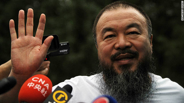 Chinese artist Ai Weiwei speaks to reporters outside his studio in Beijing in June earlier this year.