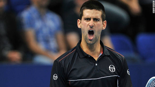 Novak Djokovic reacts to winning a point in his three-set victory over Marcos Baghdatis