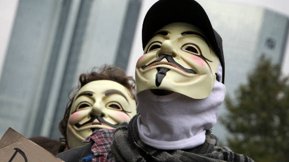 Masked protesters march in Frankfurt, Germany on October 29.