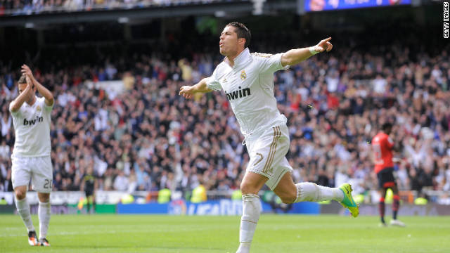 Cristiano Ronaldo celebrates one of his goals in the 7-1 thrashing of Osasuna.
