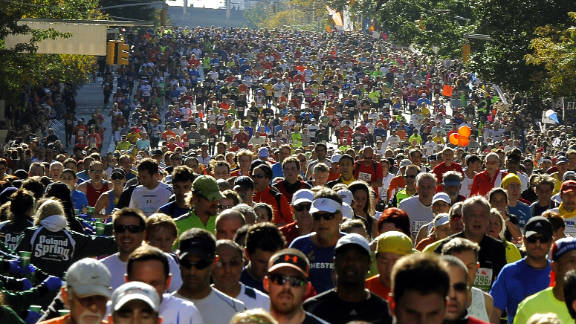 Runners make their way up 1st Avenue in Manhattan. The 26.2-mile race cuts through New York's five bouroughs.