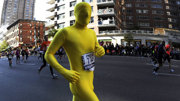 A runner in a full-body spandex suit takes part in Sunday's race.