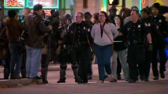 Those arrested either refused to leave the park after the 11 p.m. closing time or blocked nearby streets, police said.