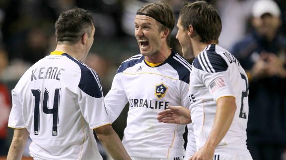 David Beckham (center) celebrates with Robbie Keane (left) during Los Angeles Galaxy