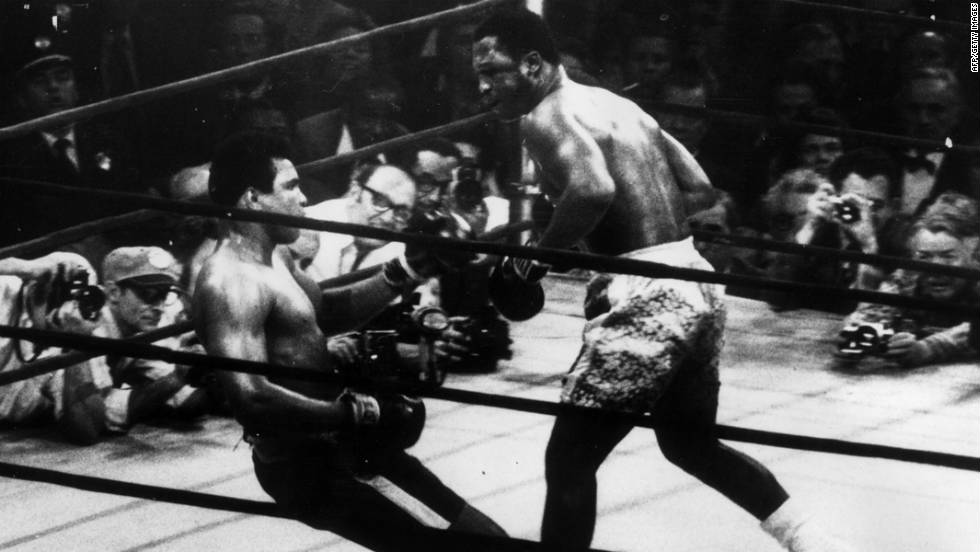 Muhammad Ali goes down in the 15th round after a left hook from world heavyweight champion Frazier in 1971, who kept the title with a unanimous points win.