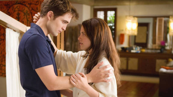 "Robert Pattinson and Kristen Stewart in ""The Twilight Saga: Breaking Dawn -- Part 1,"" which grossed a total of $221.3 million."