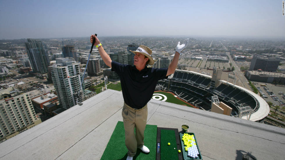 Baird celebrates after landing his ball off a hotel roof onto a bullseye at PETCO Park, home of the San Diego Padres baseball team, during a charity event in 2009.
