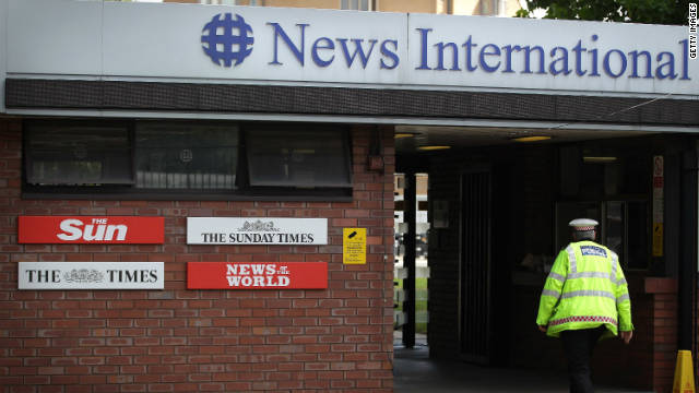A policeman walks through the security gates at News International's Wapping plant on July 7.