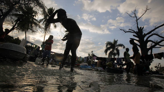 Haitians wash clothes in a stream in Port-au-Prince in January. The widespread user of rivers has been liked to the country's deadly cholera outbreak.