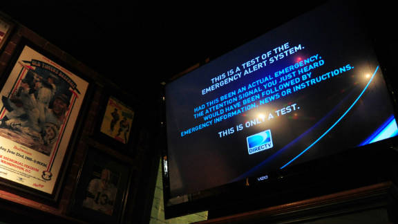The new Emergency Alert System test shows on a TV in Washington, D.C., on Wednesday.
