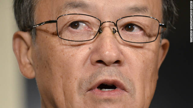 Olympus president Shuichi Takayama at  a November 8 press conference admitting a cover-up for the first time.