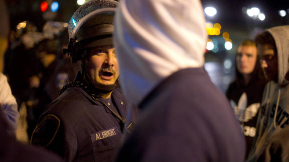 Pennsylvania State Police disperse students along East College Avenue in the early morning hours Thursday.