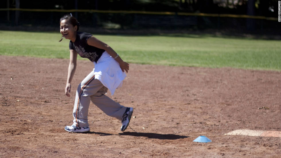Rita, a 16-year-old from Myanmar (formerly Burma), runs to second base.