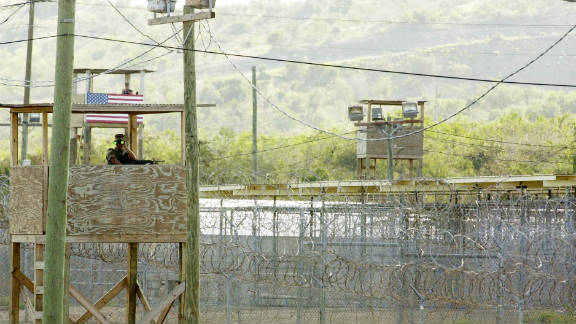 A U.S. Marine mans  an observation tower outside Camp X-Ray in Guantanamo Bay, Cuba, in a 2002 photo.