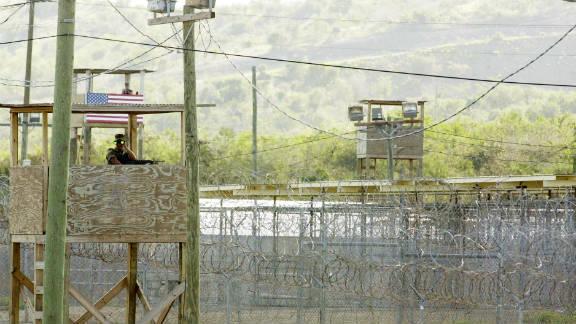 A guard keeps watch from a tower at the military facility at Guantanamo Bay, Cuba.
