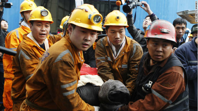 Rescuers carry out a miner from the Qianqiu colliery in Yima on November 5 2011.China has one of the world's deadliest records for miners.