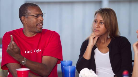 Seasoned Web entrepreneur Hank Williams, left, talking with NewMe co-founder Angela Benton.