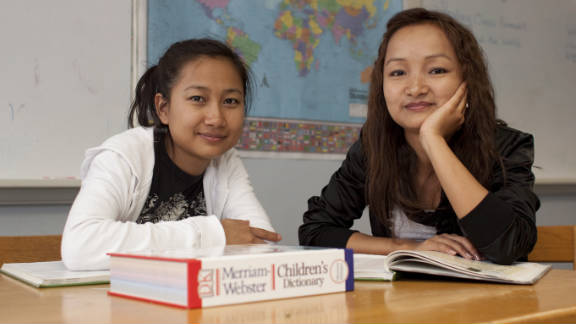 Sisters Rita, left, and Melody, right, left their parents behind when they came to the U.S. from Myanmar.