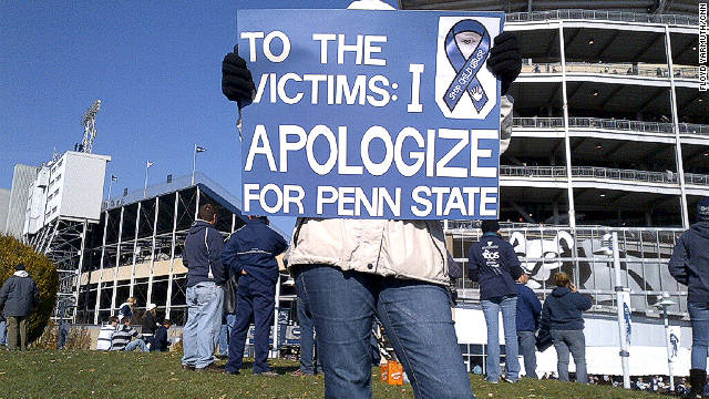 A Penn State student shows her reaction to the child abuse scandal outside Beaver Stadium on Saturday.