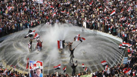 Syrians show their support for President Bashar al-Assad in Damascus on November 13.