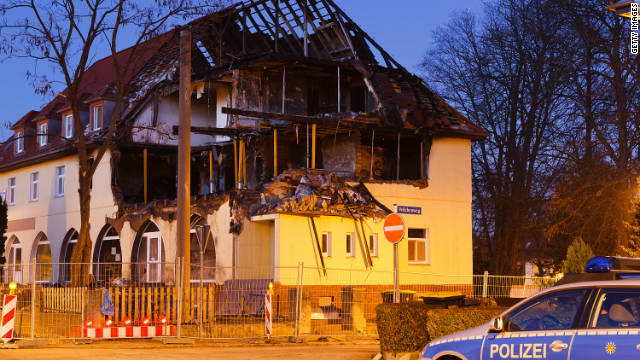 A police car stands in front of the burnt-out remains of the apartment that was once the residence of Uwe Mundlos, Uwe Boehnhardt and Beate Zschaepe on November 13, 2011 in Zwickau, Germany.