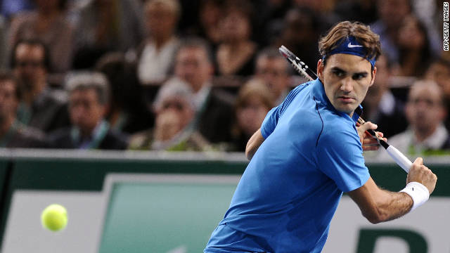 Roger Federer prepares to play a return during his Paris Masters final victory over Jo-Wilfried Tsonga