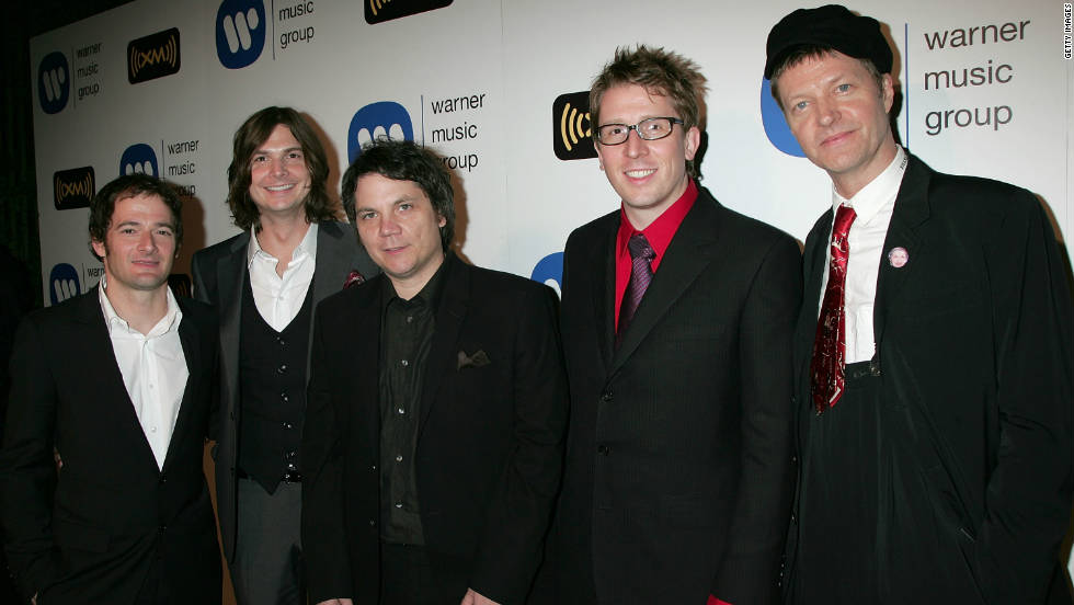 "Chicago-based Wilco includes John Stirratt, Glenn Kotche, Jeff Tweedy, Mikael Jorgensen and Nels Cline. Formed in 1994, these alternative rockers have sold 2 million albums and won two Grammy awards for 2004's ""A Ghost is Born."" Their Top 10 singles include ""I Might,"" ""Speak into the Rose"" and ""Random Name Generator."""