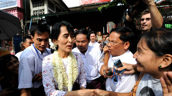 Myanmar democracy icon Aung San Suu Kyi greets her supporters after her press conference on the anniversary of her release at the National League for Democracy (NLD) headquarter in Yangon on November 14, Myanmar.