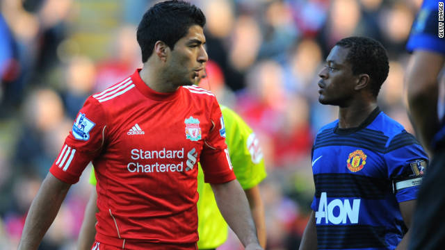 Luis Suarez (L) and Patrice Evra clashed during the game between Liverpool and Manchester United in October.