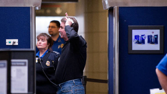 A man underdoes a full body scan before heading to his flight at Pittsburgh International Airport last year.