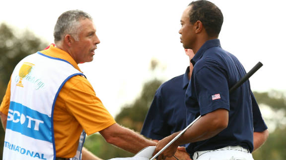 Tiger Woods and Steve Williams shake hands after the International pairing