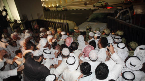 Protesters break open the gate as they storm the Kuwaiti National Assembly in Kuwait City on Wednesday.