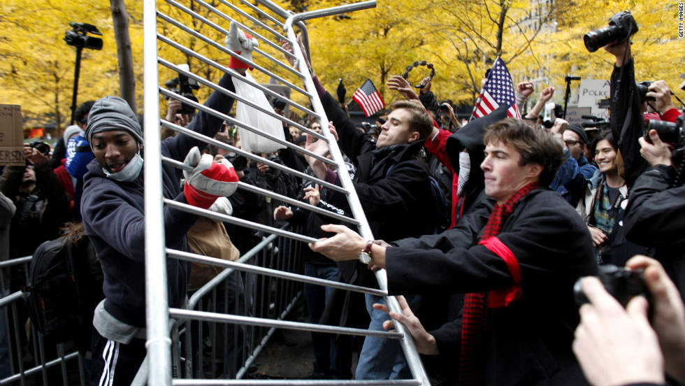 Protesters remove metal barricades Thursday in Zuccotti Park, where they had been evicted two days earlier.