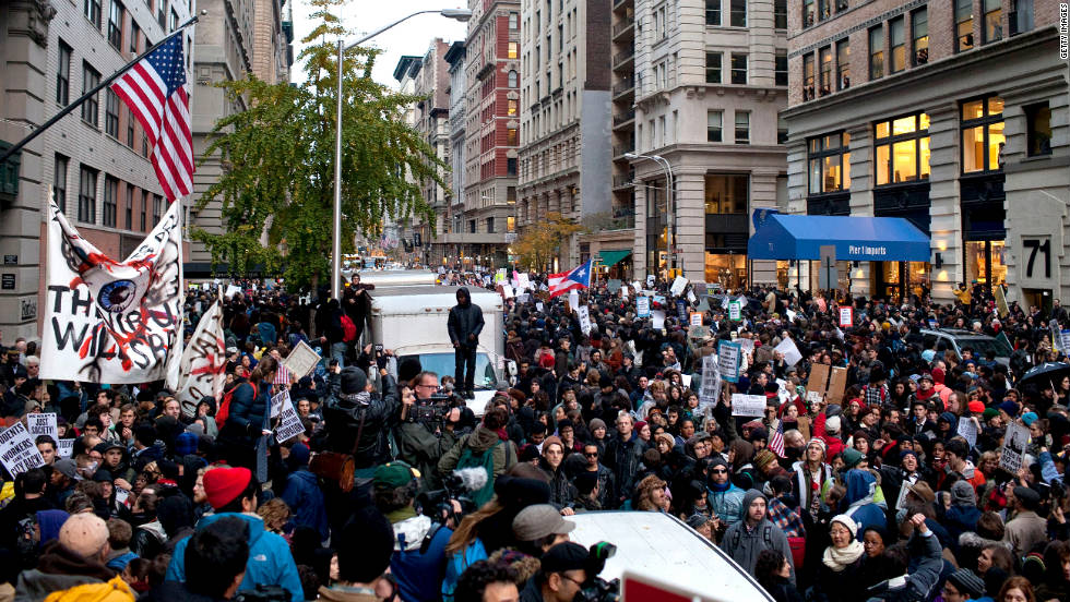 Thousands of demonstrators deluged the city, marking two months since the activist effort began in Lower Manhattan.