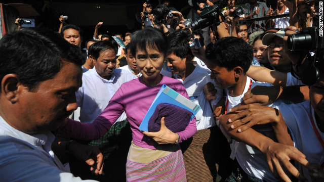 Myanmar pro-democracy leader Aung San Suu Kyi leaves the National League for Democracy party offices on November 18, 2011.