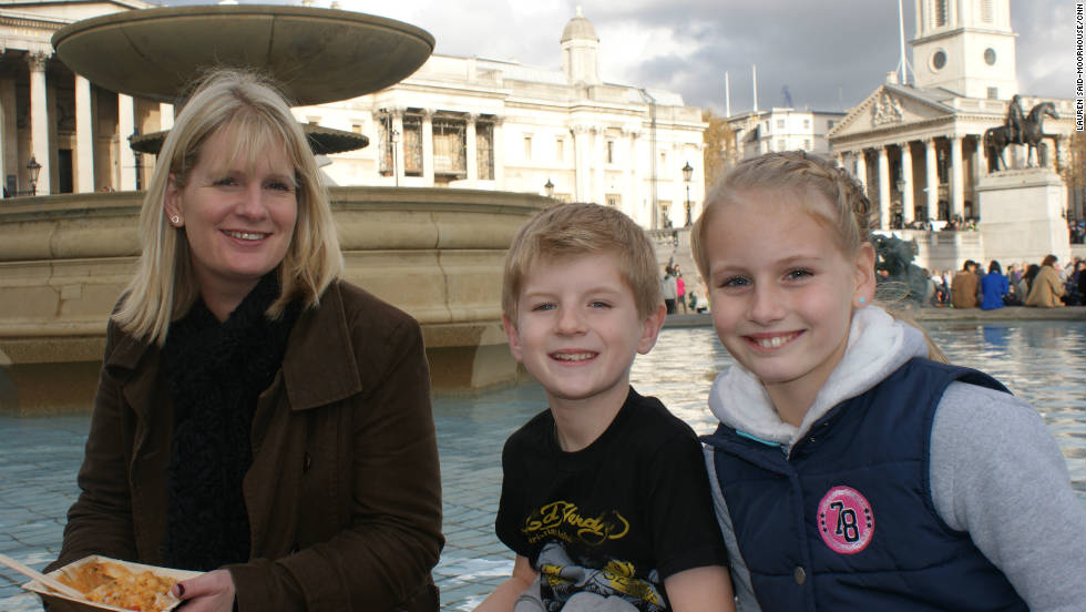 "Holly Smith (left) brought her children Darcie and Mackenzie to the food waste event to teach them about the subject after reading about it online. She says: ""I didn't quite realize how much food waste there is... I'm not the greatest cook in the world. But when I see this and how simple it is, it will make me take out the cauliflower and think of something to do."""