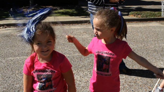 Grandchildren Ashleigh Wyatt, left, and Ava Welch are two of Moore's most ardent fans.