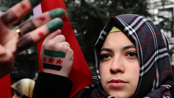 A Syrian woman living in Turkey protests against the government of Syria