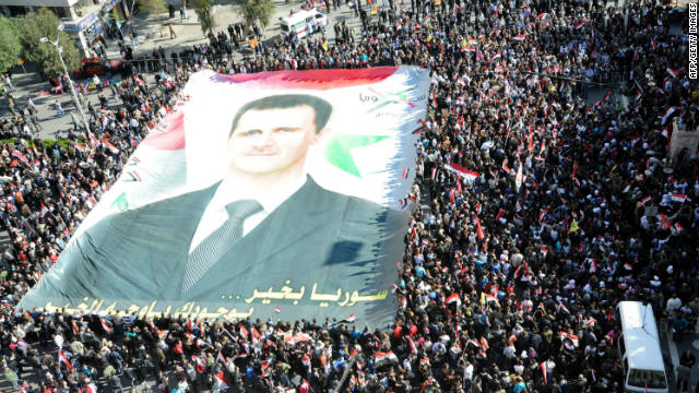 Supporters of Syrian President Bashar al-Assad rally in Damascus on Sunday.