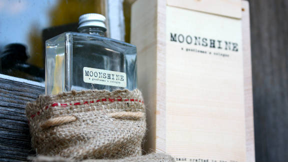 Three fraternity brothers have captured the essence of moonshine in a creative cologne.