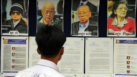 A Cambodian man looks at pictures of former Khmer Rouge leaders in 2011 on trial for their role during the bloody four-year regime.